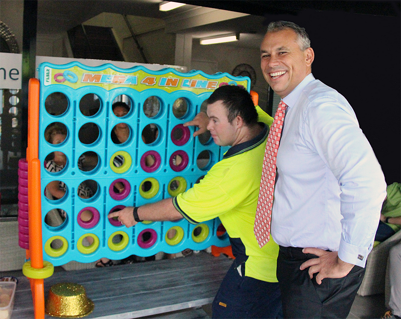 Chief Minister visits Somerville and challenges staff to a game of connect 4!