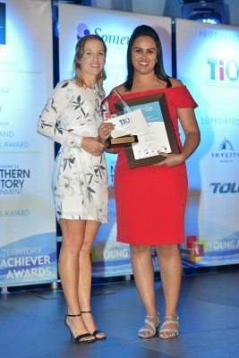 Aditi receiving her award